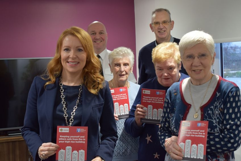 Community Safety Minister Ash Denham launches fire safety leaflet for high-rise residents.