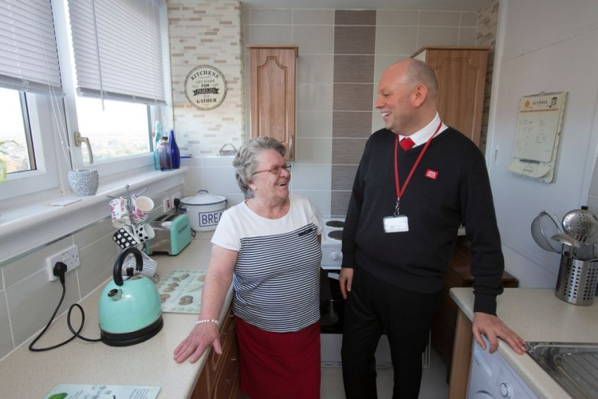 GHA housing officer and tenant in kitchen
